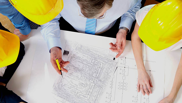 Builders reviewing construction plan
